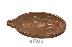 A coin is LP MHUN, Wat Banjan, Thailand, Code Number 1, Thai Buddha Amulet