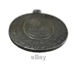 A coin is LP RHUN, GOU YOD, Generation frist, Silver, year1917, Thai Buddha Amulet